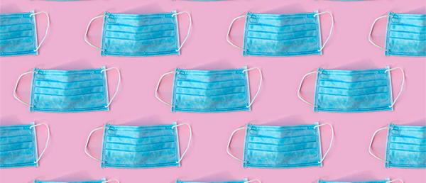 blue face masks on a pink background