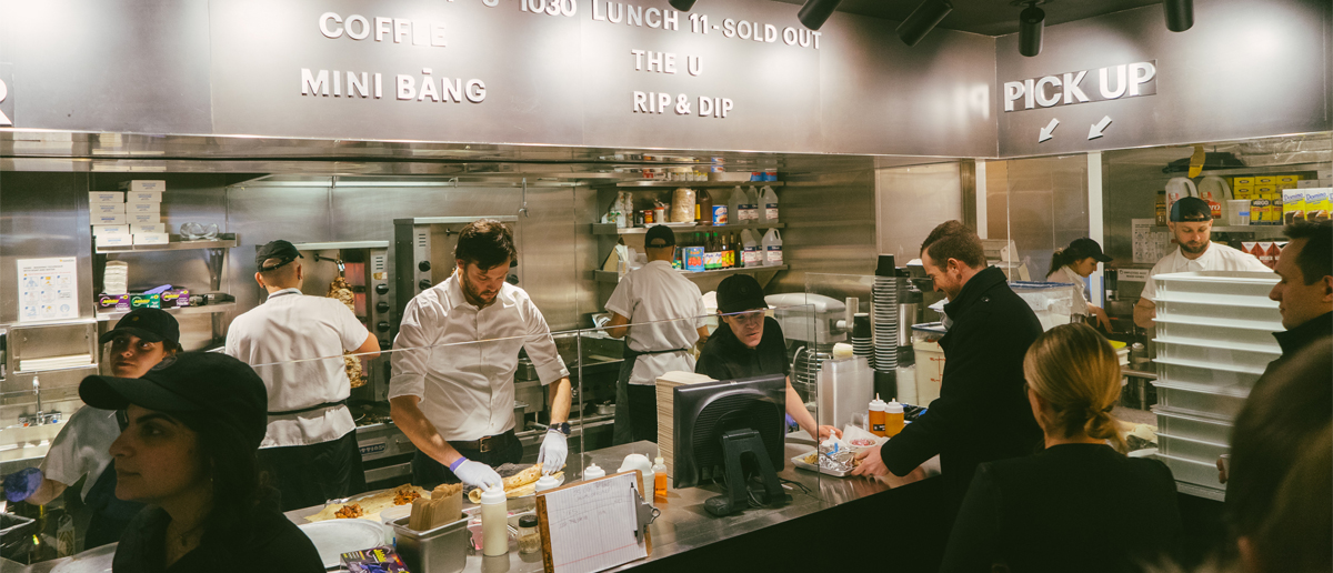 lunchgoers grab food from a busy Bang Bar counter in The Shops at Columbus Circle