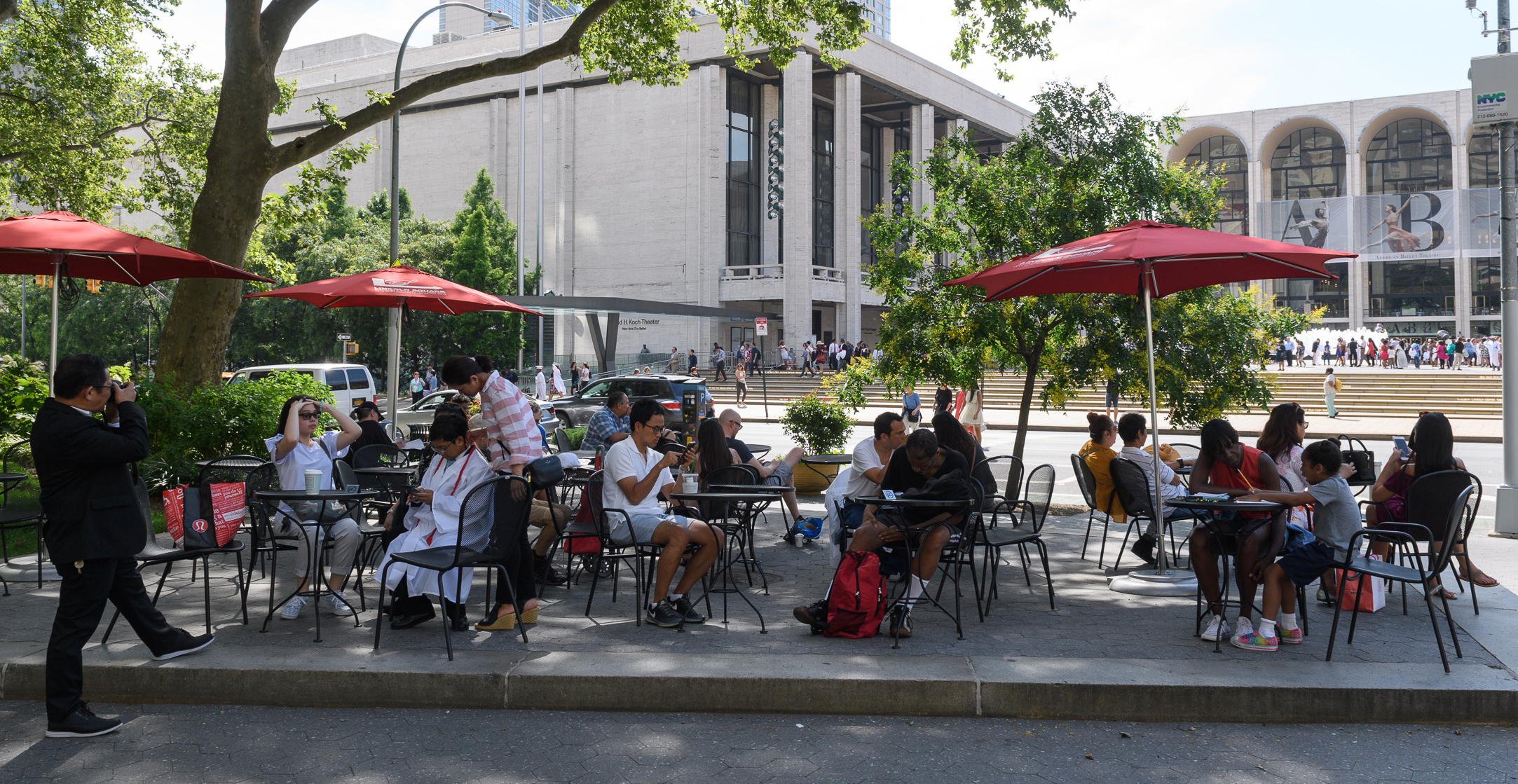 patrons sit and enjoy Dante Park's raised seating area
