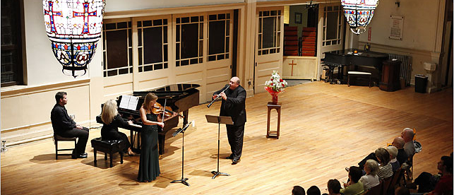 players perform before an audience at the church of st paul