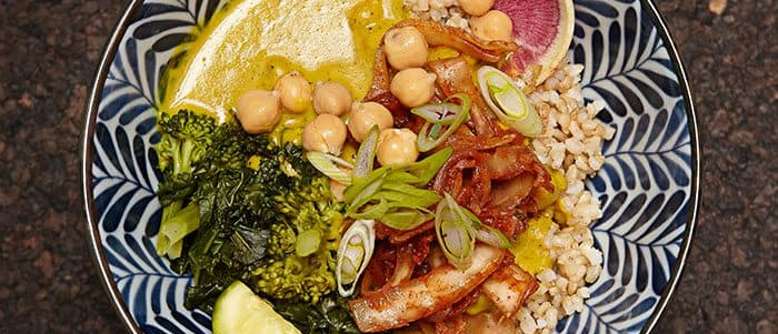 a plate of vegan curry over rice with chickpeas_ broccoli_ and more from Le Bontaniste