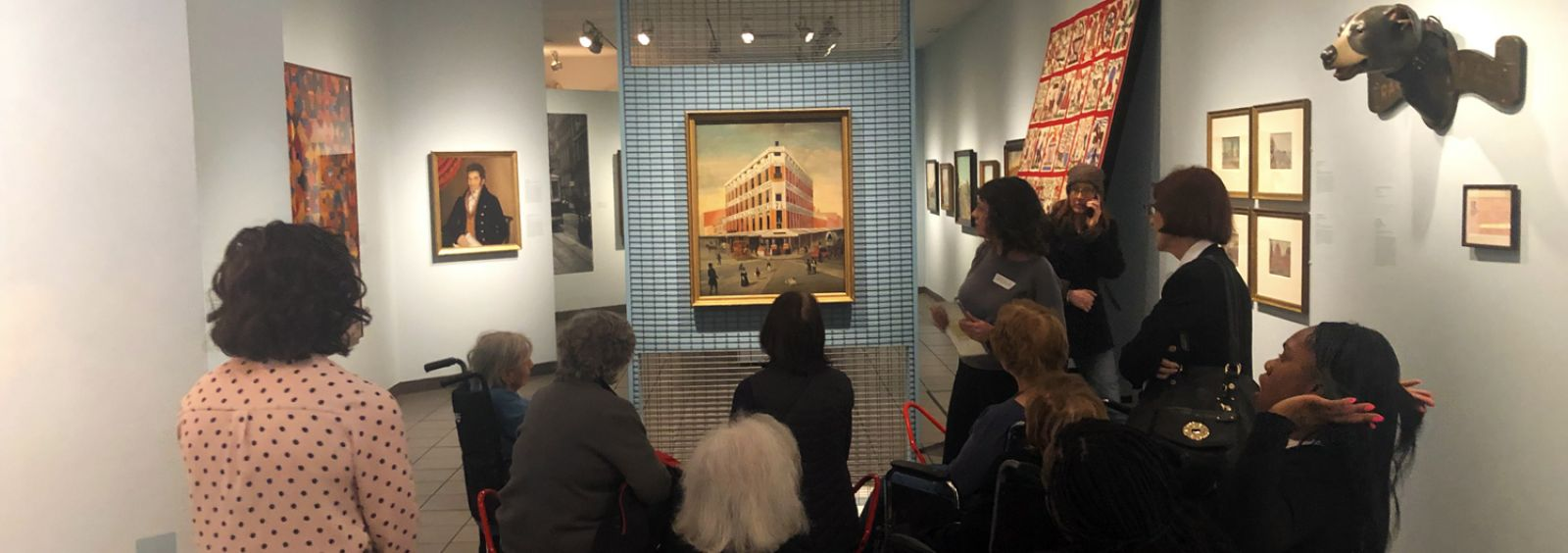 Museum patrons admire art in the American Folk Art Museum's new exhibit ----