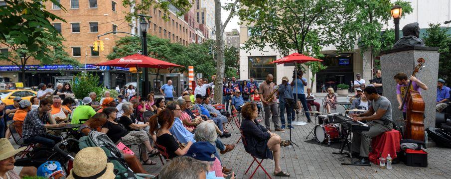 parkgoers enjoy free music in Richard Tucker Park in the summer