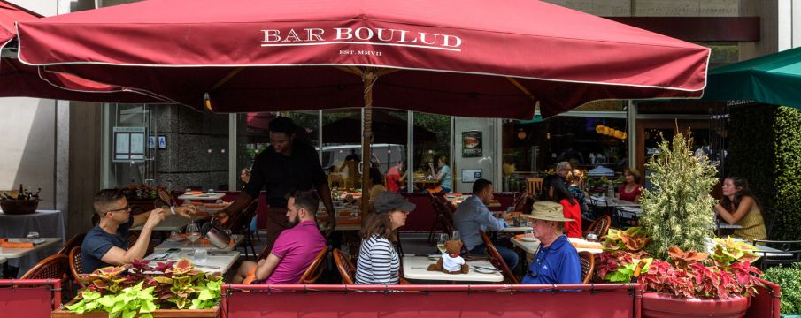 patrons enjoy outdoor seating at Bar Boulud on Broadway in the summer