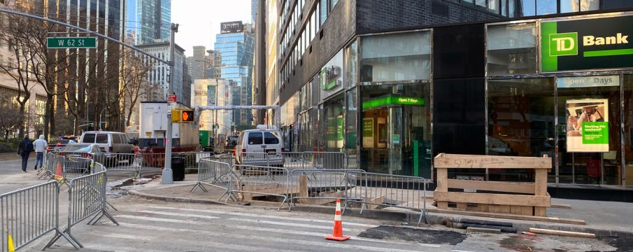 photo looking down the Bway sidewalk from west 62nd street with many barricades and additional construction