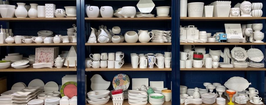 shelves of pottery waiting to be painted at Color Me Mine