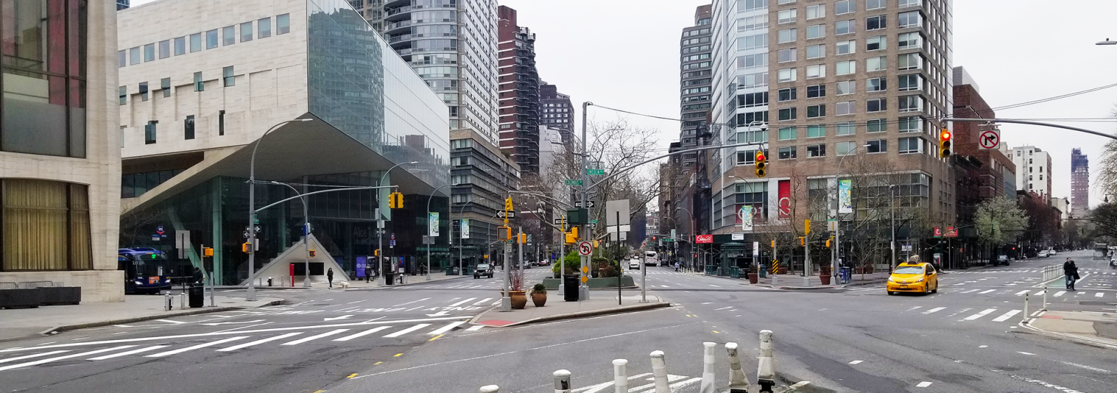 the nearly empty intersection of Broadway, Columbus Ave, and 65th Street in March 2020