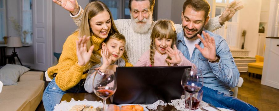 family centered around a computer