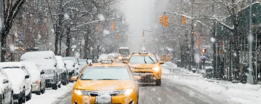 Taxis driving through NYC in the snow