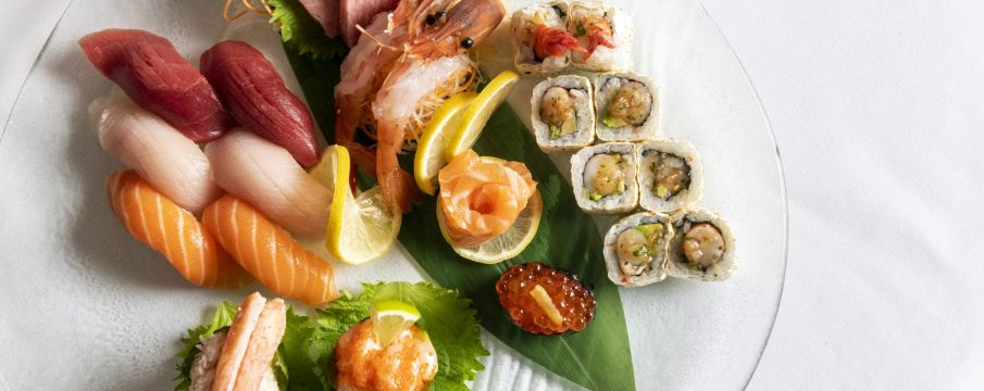 various sushi rolls and pieces of sashimi arranged on a plate from Atlantic Grill
