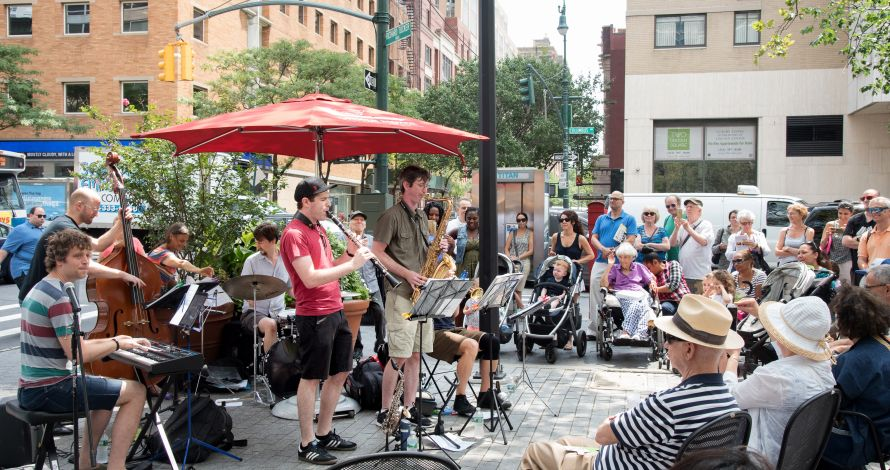 A local band plays music in Richard Tucker Park as part of the BID's Lunchtime Concert Series