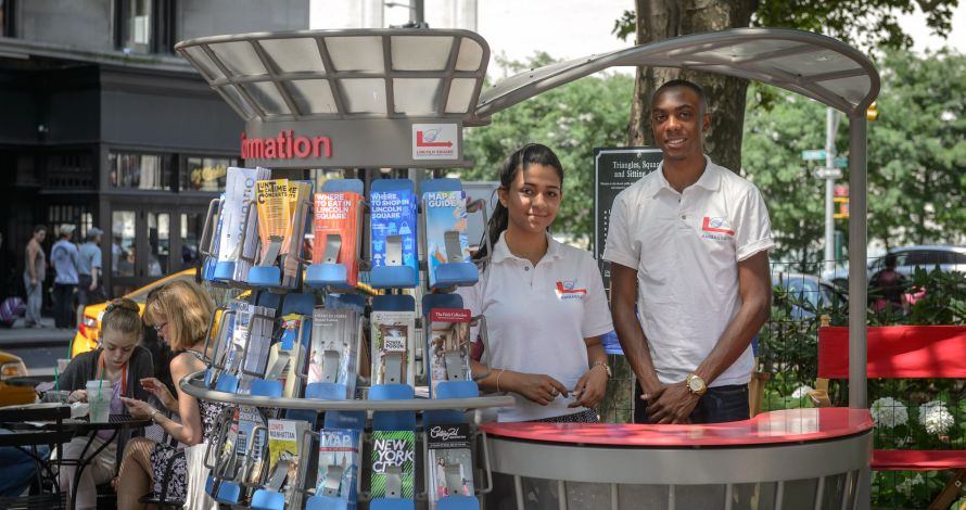 Two students work as Information Ambassadors at one of the BID's three Information Carts